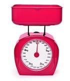 Échelle rouge de poids Photos libres de droits