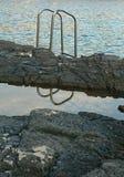 Échelle vers la mer Photos stock