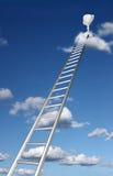 Échelles à un trophée sur un nuage Image stock