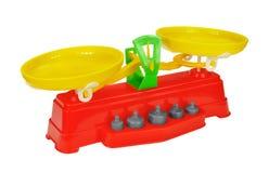 Échelles de jouet avec des poids Photographie stock