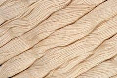 Écheveaux beiges de soie comme texture de fond Photo stock