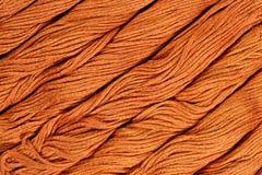 Écheveaux de Brown de soie comme texture de fond Images libres de droits