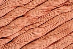 Écheveaux de Brown de soie comme texture de fond Photographie stock libre de droits