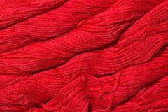 Écheveaux rouges de soie comme texture de fond Photographie stock