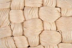 Écheveaux tordus beiges de soie comme texture de fond Photographie stock