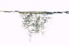 Éclaboussement de l'eau d'or Photos libres de droits