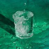 Éclaboussement de l'eau de la glace Photo libre de droits