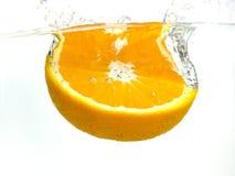 Éclaboussement de l'orange photos stock