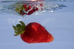 Éclaboussement de la fraise Photographie stock
