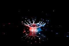 Éclaboussure blanche et bleue rouge Photo libre de droits