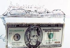 éclaboussure de $20 factures Images libres de droits