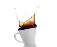 Éclaboussure de café d'une tasse Photos libres de droits