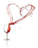 Éclaboussure de coeur d'un verre de vin rouge Photo stock