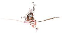 Éclaboussure de l'eau de couleurs rouges psychédéliques Photos libres de droits