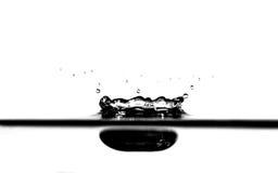 Éclaboussure de l'eau en noir et blanc Photos stock