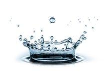 Éclaboussure de l'eau sur le blanc Photos stock