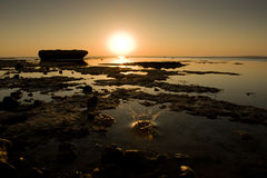 Éclaboussure de lever de soleil photographie stock libre de droits