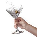 Éclaboussure de martini chez la main de la femme d'isolement Photographie stock libre de droits