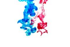 Éclaboussure de peinture bleue et rouge Photo stock