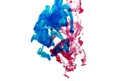 Éclaboussure de peinture bleue et rouge Images libres de droits