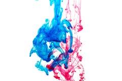 Éclaboussure de peinture bleue et rouge Photographie stock libre de droits