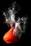 Éclaboussure de poivron rouge photo stock
