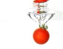 Éclaboussure de tomate Photos libres de droits