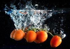 Éclaboussure de tomates Images stock