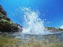 Éclaboussure de vague Photographie stock