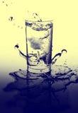 Éclaboussure de verre et d'eau cristal Photographie stock libre de droits