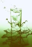 Éclaboussure de verre et d'eau cristal Photos stock