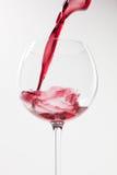 Éclaboussure de vin sur le fond blanc Photos libres de droits