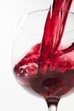 Éclaboussure de vin sur le fond blanc Photos stock