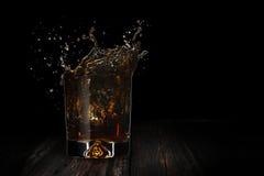 Éclaboussure de whiskey Images stock