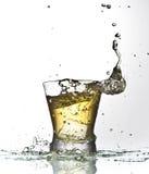 Éclaboussure jaune de boissons Photos stock