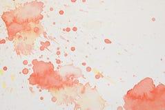 Éclaboussure rouge et jaune lumineuse d'aquarelle Photo libre de droits