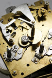 Éclairage abstrait sur le mécanisme d'horloge Image libre de droits