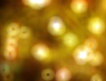 Éclairage d'or de fond de tache floue Photos stock