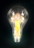 Éclairage de fille dans l'ampoule Images stock