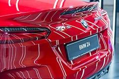 Éclat de lumière au dos de BMW rouge Z4 images libres de droits