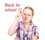 Écolière avec le mrker rouge à disposition Photo libre de droits