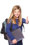 Écolière avec les pouces de sourire d'ordinateur portable vers le haut Images libres de droits