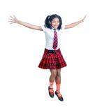 Écolière dans des sauts uniformes Photographie stock