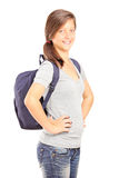 Écolière de sourire avec la pose de sac à dos Photographie stock libre de droits