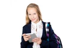 Écolière de sourire avec le comprimé photo libre de droits