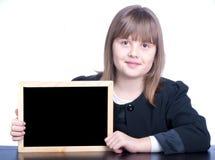 Écolière et conseil Photographie stock