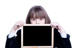 Écolière et conseil Photographie stock libre de droits