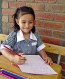 Écolière heureuse. Image stock