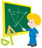 Écolier à la géométrie de leçon Image stock
