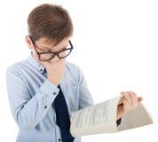 Écolier étonné avec le livre Image stock